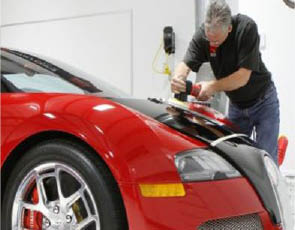 auto body repair technician working on a car in Cathedral City, CA