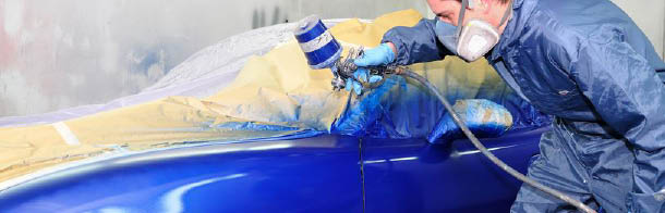 a fresh coat of blue paint being sprayed onto a car