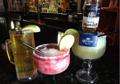 Treat yourself to a refreshing margarita at Papa Lopez
