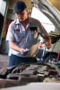 photo of technician changing car oil at Pennzoil 10 Minute Oil Change in Taylor, MI
