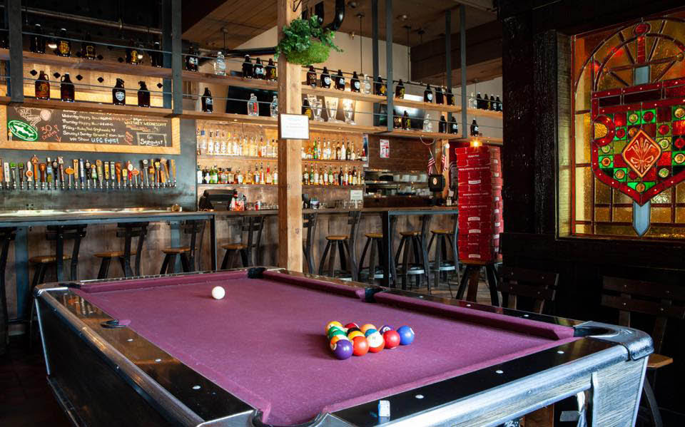 Play pool at Canterbury Ale House Bar & Grill on Capitol Hill in Seattle, Washington - Seattle restaurants near me - dining in Seattle, WA - dining coupons near me - restaurant coupons near me - pool tables