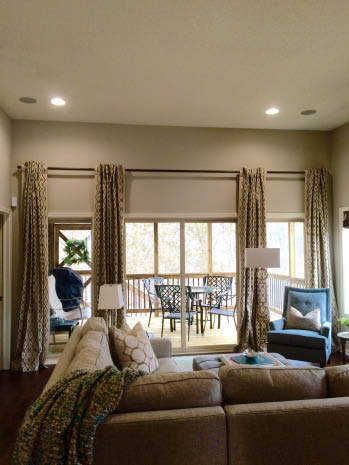 Budget Blinds decorative panel accent drapes in a living room in Des Moines, IA; Ankeny, Iowa