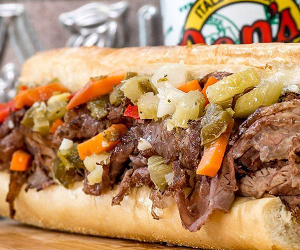 Overstuffed beef steak sandwich