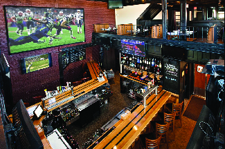 Our custom Sports bar at Portside Tavern is great for the Game. 33 TVs, 24 Craft Beers & a great bar staff