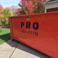 a Pro Waste Services, Inc. waste removal bin at a residence in Erie, PA