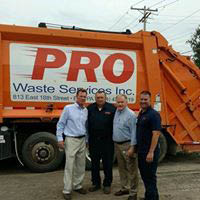 Pro Waste Services, Inc. waste removal truck and workers.