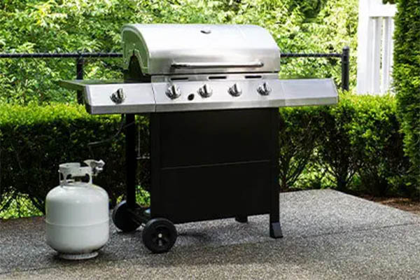 gas grill with propane tank beside it