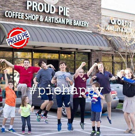 Happy Proud Pie customers near restaurant exterior in Katy, TX