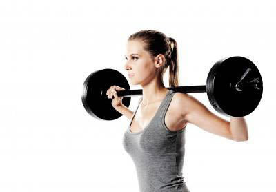 Women's strength training with barbells results in body toning