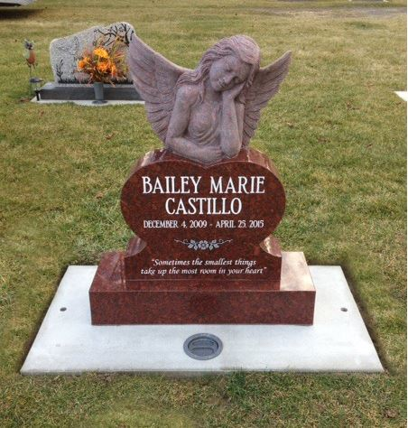 Beautiful upright headstone monument for a young girl designed by Edgewood Monuments in Puyallup, Washington