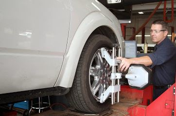 photo of mechanic installing tire at Quick Lanes Hines Park in New Hudson, MI