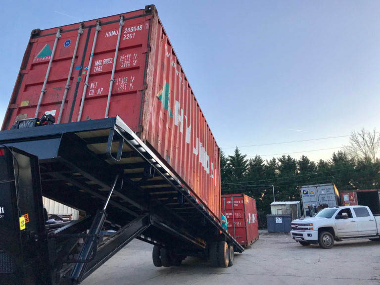 Shipping container being delivered