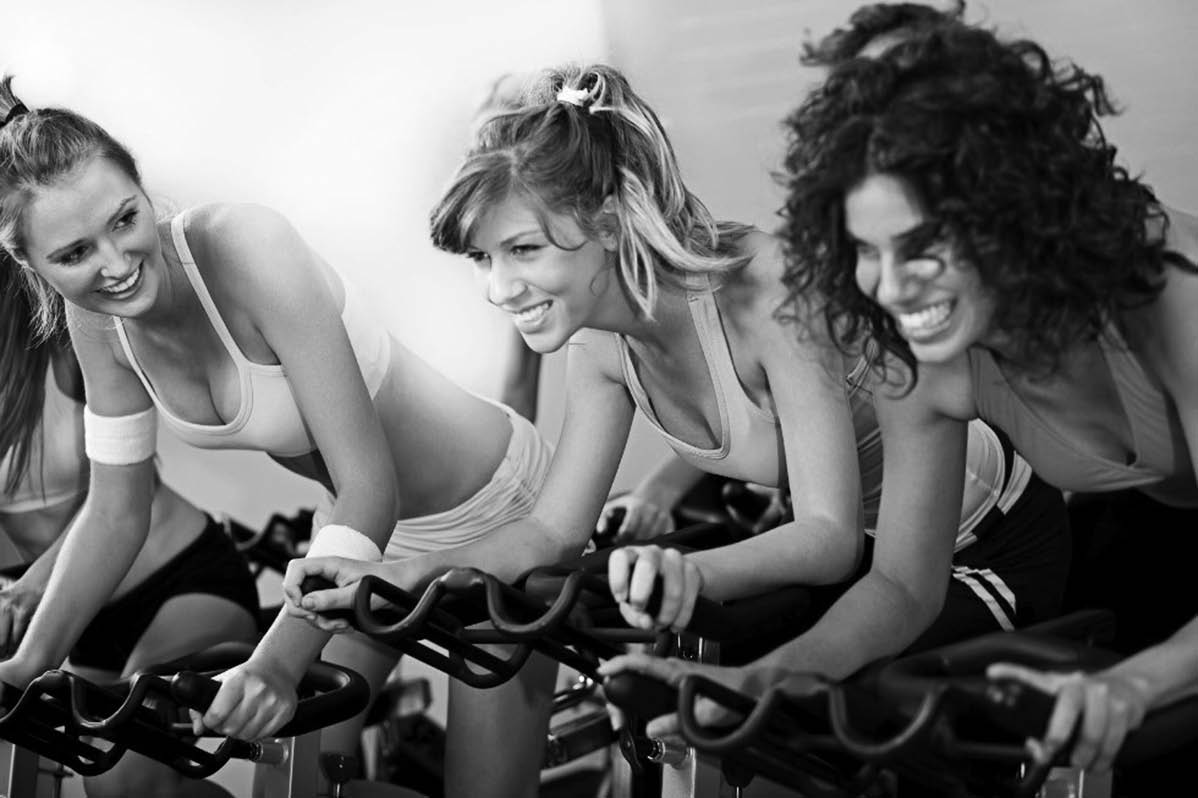 photo of women enjoying cycle class at ReCYCLE Fitness in Washington and Shelby Twp, MI
