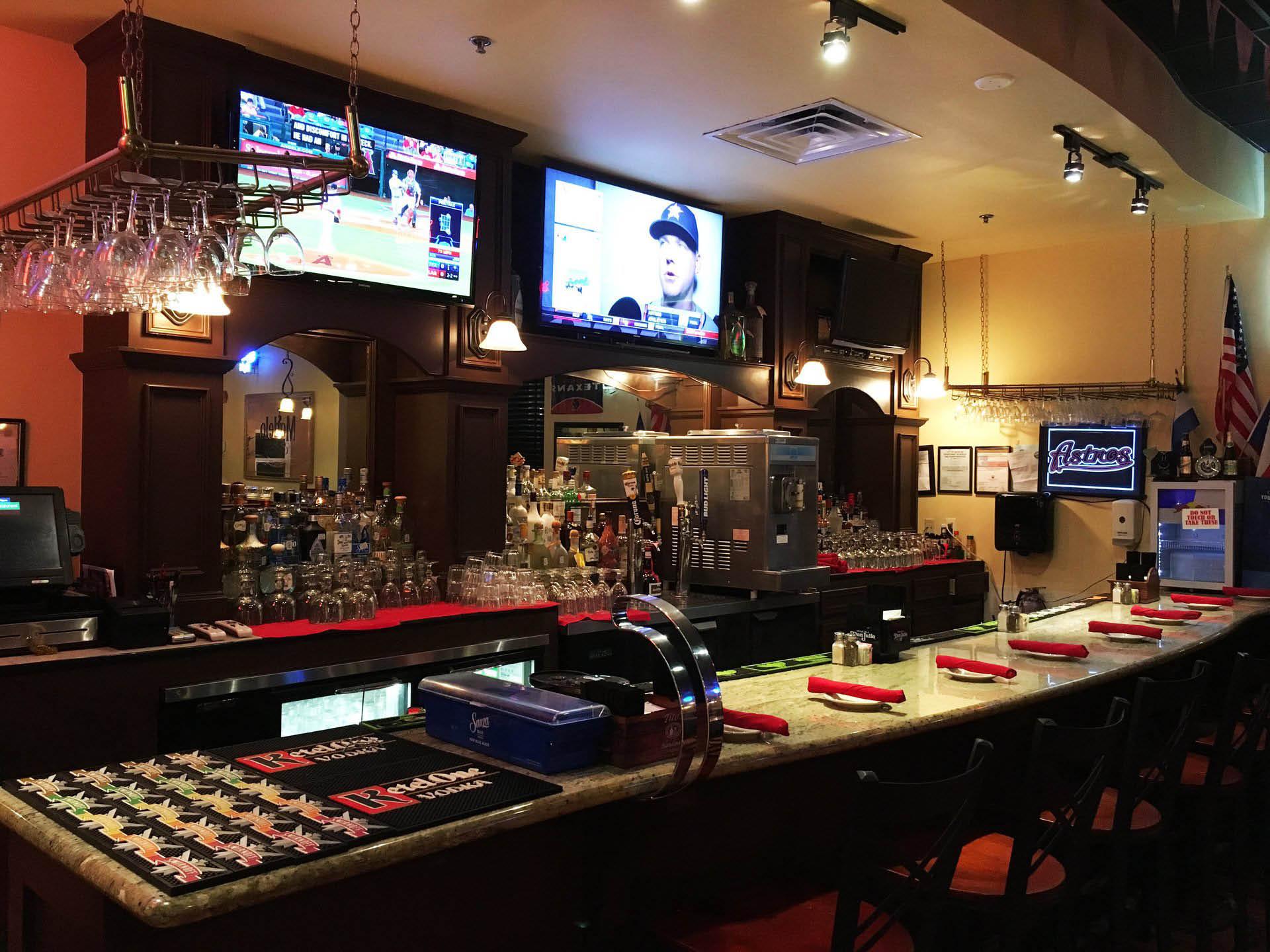 El Rancho bar interior with big screens playing sports