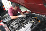 photo of auto mechanic working on engine at Rochester Hills Chrysler Jeep