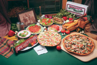 spread of pizza and Italian dishes; Chicago catering services by Rosati's Authentic Chicago Pizza in Schaumburg, IL