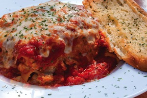 homemade meat lasagna and garlic bread from Rosati's Pizza and Italian food in Lemont & Manhattan, IL.
