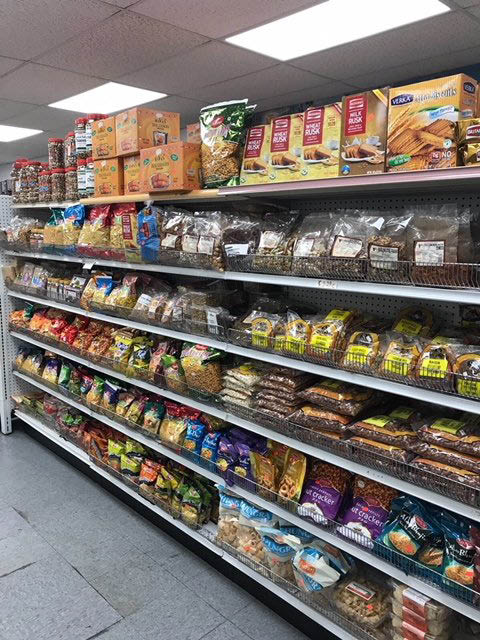 Indian groceries on fully stocked shelves