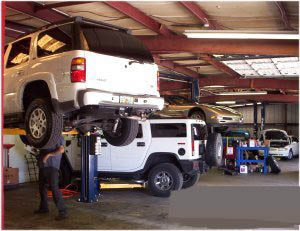 ase certified technicians working in garage storm auto repair tampa, fl