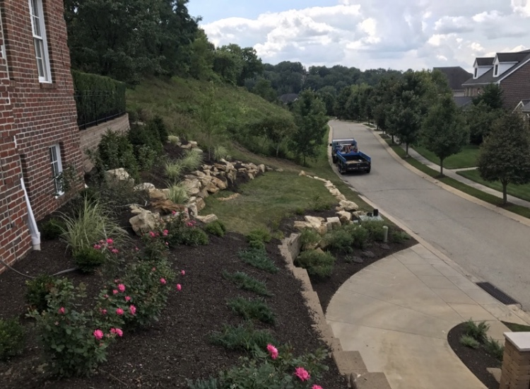 landscaping symanski patios deer resistant shrubbery pathways fire pits flower bed water falls ponds spring/fall cleanup   lawn care maintenance edge & mulch & pruning