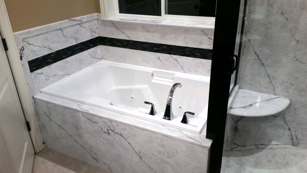 Granite bathtub for an upscale bathroom redesign. Come see our showroom now located at 2620 Wadman in Ogden.