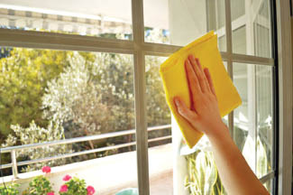 Schneider hand cleans interior windows to clear again