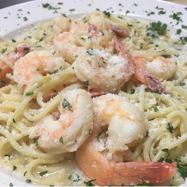 Enjoy delicious homemade shrimp fettuccine alfredo at Cinema Pizza