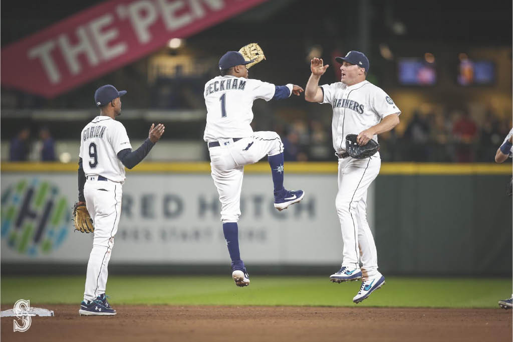 Seattle Mariners celebrating after a terrific play - buy Mariners tickets