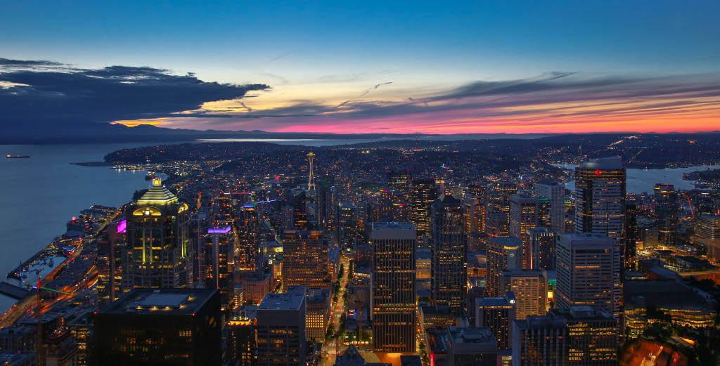 Gorgeous view of Seattle at night from the Sky View Observatory in the Columbia Center in downtown Seattle, WA - night view of Seattle from Sky View Observatory - entertainment coupons near me