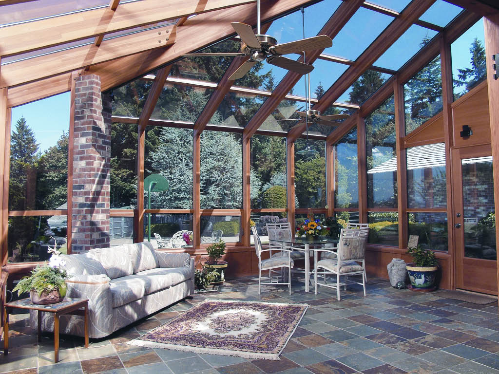Enjoy your beautiful sunroom rain or shine - sunroom protection from the sun - sunroom protection from the rain - gorgeous sunrooms installed by the professionals at Seattle Patio Covers in Federal Way, WA