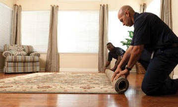 photo of technicians rolling cleaned rugs from ServiceMaster Clean in Mason, MI