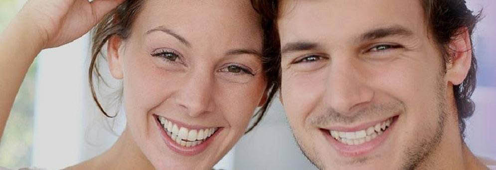 photo of smiling couple with teeth cleaned by SHiva Hogugi, DDS, PLLC in West Bloomfield Twp, MI