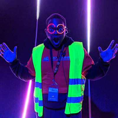 Skyzone employee in glow in the dark gear