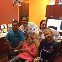 happy family with nice smiles; teeth whitening; root canal; Invisalign; Smile Studio 87 dentists Chicagoland, IL