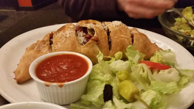 Calzone and salad from Soprano's Pizza & Pasta in Ballard, WA - Ballard Italian restaurants near me - Italian restaurant coupons near me - Italian dining near me in Seattle and Ballard
