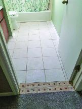 Tile and grout bathroom flooring