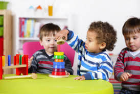 three toddler boys playing with blocks; child care centers in NM