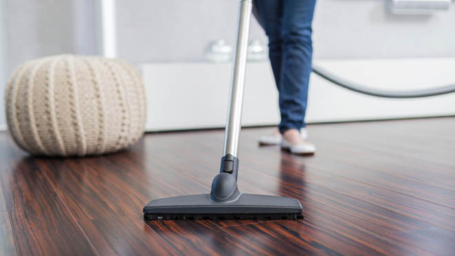 Sparkling House Cleaning - vacuuming the floor - sweeping the floor - housekeeping services - maid services - housecleaning services