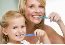 photo of mother and child brushing teeth representing Square Lake Family Dentistry in Troy, MI