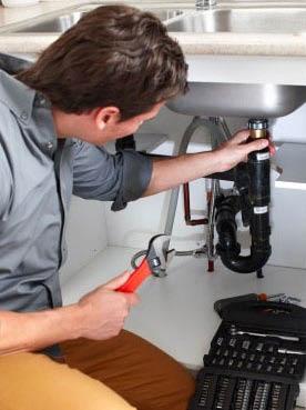 Certified plumbers repairing a sink near Martinez, CA