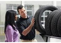 photo of tire salesman helping woman at Super Tire in Livonia, MI