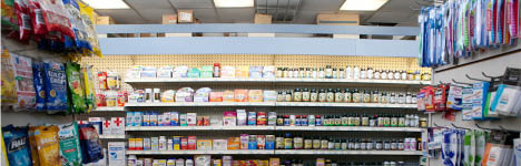 far away view of store shelves filled with vitamins and supplements in Syd's Pharmacy and Kosher Vitamins in Los Angeles