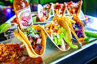 variety of tacos; crunchy tacos; soft tacos; burritos; nachos