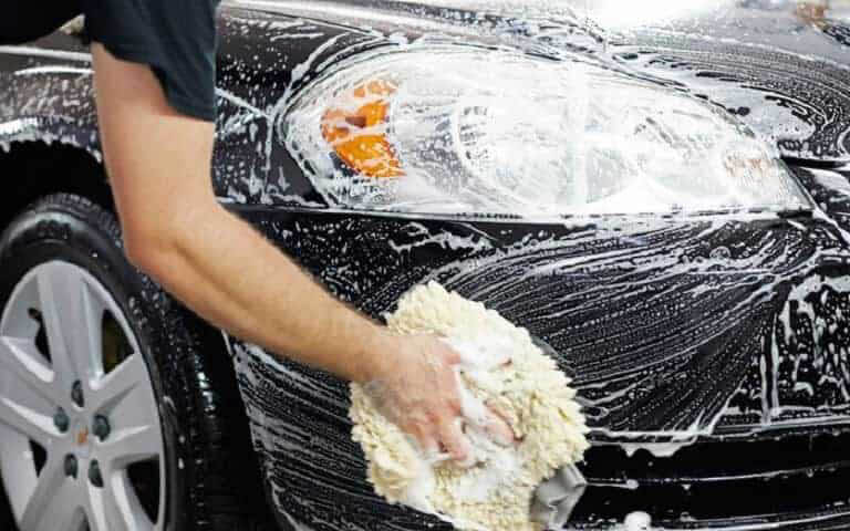 We hand prep and wash your car before you go into Pink Dolphin Car Wash in Tacoma, Washington - wash my car - Tacoma car wash near me - car washes near me in Tacoma - car wash coupons near me