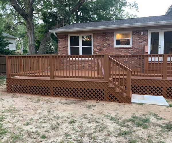 Patio porch with lattice, stairs and deck rails