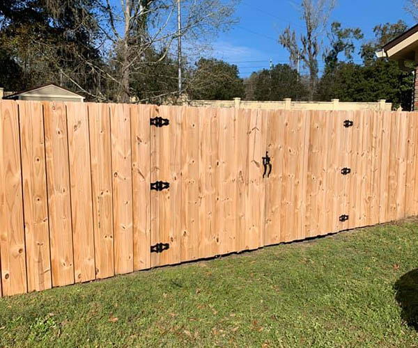 New fence with gates by Tallahassee Fence Painting
