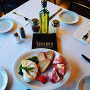 full set table with olive oil and breads at Taverna on Division street in Melrose, IL