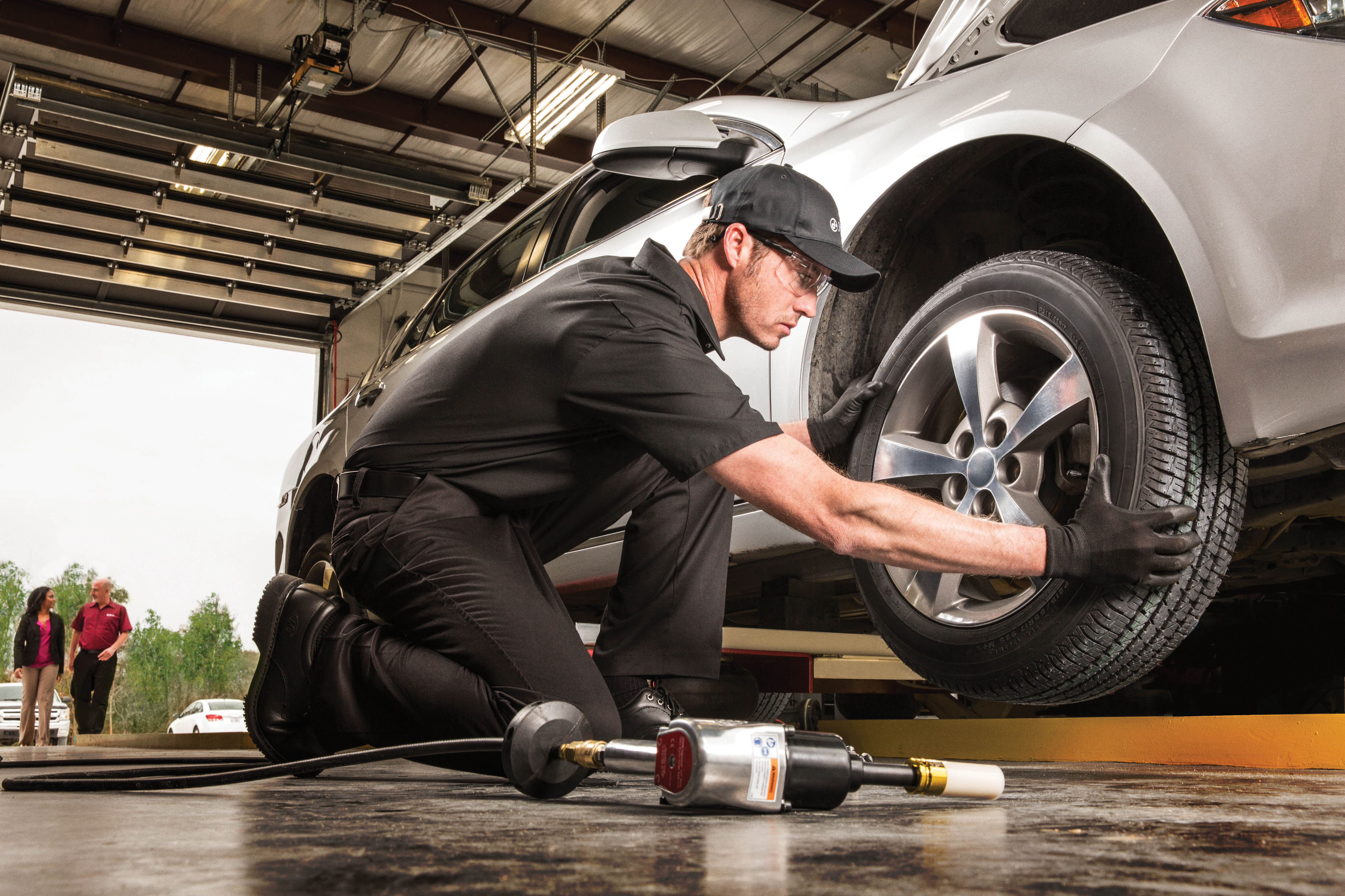 auto mechanic performing a tire tread test; Jiffy Lube Bellflower, CA oil change near me