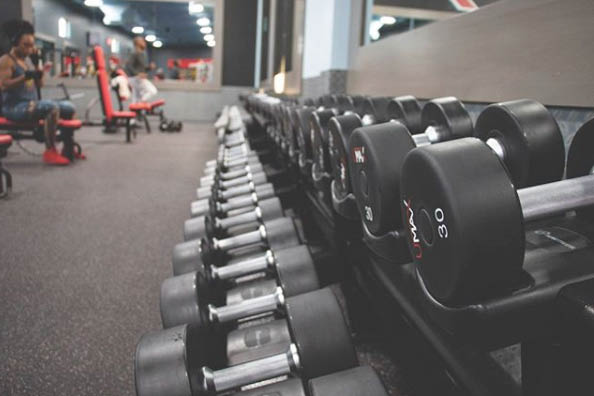 Huge weight room at Texas Family Fitness in Garland, Texas - free weights at the large Texas Family Fitness weight room in Lewisville, TX - Texas health clubs near me - Texas gyms near me
