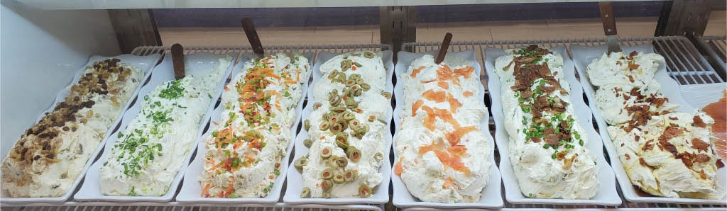 Huge assortment of homemade cream cheeses at The Bagel Place in Mt Arlington NJ
